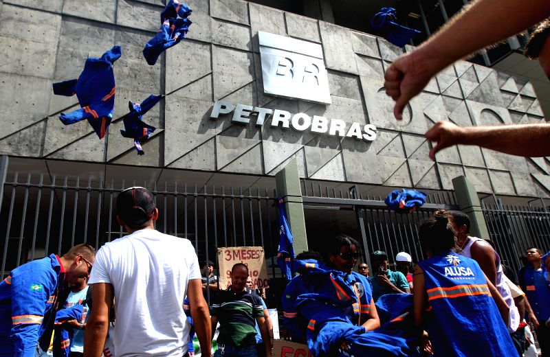 Workers of Alumini company providing services to Petrochemical Complex of Rio de Janeiro take part in a protest in front of the Petrobras building in Rio de ..