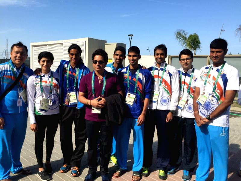 Rio De Janeiro: Former Indian cricketer Sachin Tendulkar with the Indian badminton team at the Games Village in Rio de Janeiro on Aug. 6, 2016. - Sachin Tendulkar