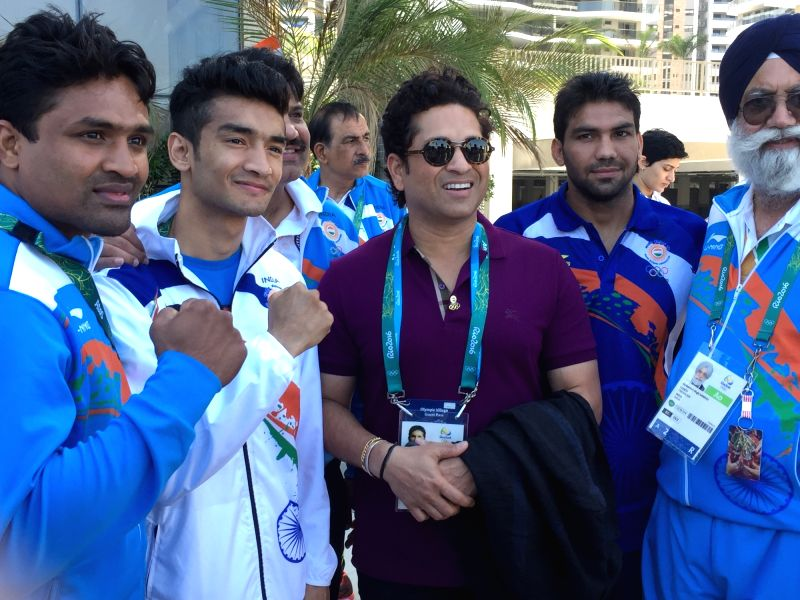 Rio De Janeiro: Former Indian cricketer Sachin Tendulkar with the Indian boxing team at the Games Village in Rio de Janeiro on Aug. 6, 2016. - Sachin Tendulkar