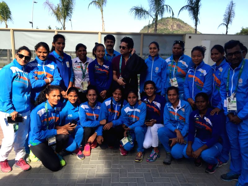 Rio De Janeiro: Former Indian cricketer Sachin Tendulkar with with Indian women hockey player and other athletes at the Games Village in Rio de Janeiro on Aug. 6, 2016. - Sachin Tendulkar