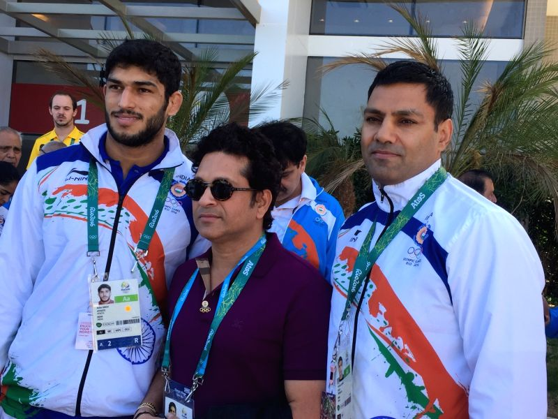 Rio De Janeiro: Former Indian cricketer Sachin Tendulkar with judoka Avtar SIngh and and his coach at the Games Village in Rio de Janeiro on Aug. 6, 2016. - Sachin Tendulkar