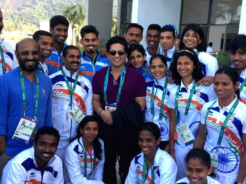 Rio De Janeiro: Former Indian cricketer Sachin Tendulkar with the Olympic team at the Games Village in Rio de Janeiro on Aug. 6, 2016. - Sachin Tendulkar