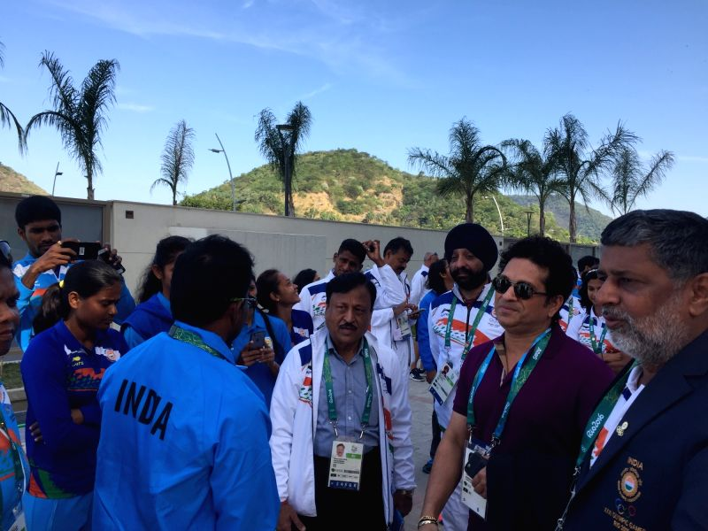 Rio De Janeiro: Former Indian cricketer Sachin Tendulkar being introduced to the Olympic team by Rakesh Gupta, Chef de Mission, Indian Olympic Team at the Games Village in Rio de Janeiro on Aug. 6, ... - Sachin Tendulkar and Rakesh Gupta