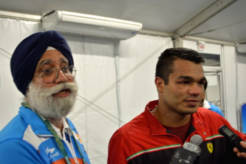 Rio de Janeiro: Indian boxer Vikas Krishan Yadav and boxing head coach GS Sandhu speaking to media after his bout against Charles Conwell of the US in the men' Middleweight (75kg) category at the ... - Vikas Krishan Yadav
