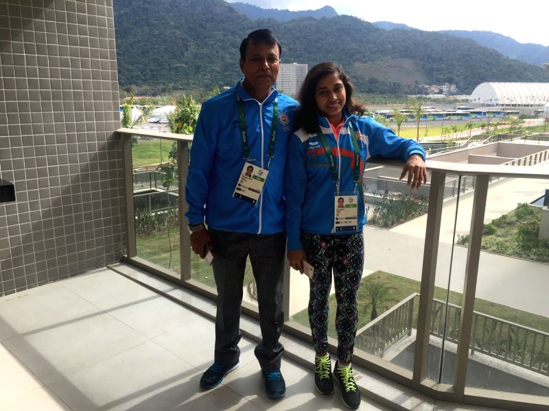 Rio De Janeiro: Indian Gymnast Dipa Karmakar with her coach Biseswar Nandi at the Olympic Village in Rio De Janeiro on July 31, 2016.