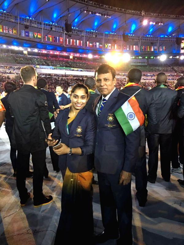Rio De Janeiro: Indian Gymnast Dipa Karmakar with her coach Biseswar Nandi during the opening ceremony of the 2016 Rio Olympic Games at Maracana Stadium in Rio de Janeiro, Brazil, Aug. 5, 2016.