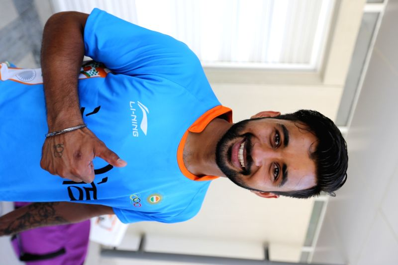 Rio De Janeiro: Indian Hockey team player poses for a phottograph after winning the match against Ireland at the games village in Rio de Janeiro on Aug. 6, 2016.