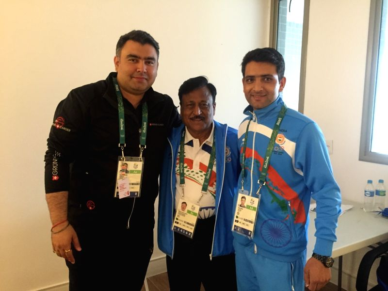 Rio De Janeiro: Indian rifle shooter Gagan Narang, Chef de Mission of the Indian contingent Rakesh Gupta and rifle shooter Chain Singh at the Olympic Village in Rio De Janeiro on July 29, 2016. - Rakesh Gupta and Singh