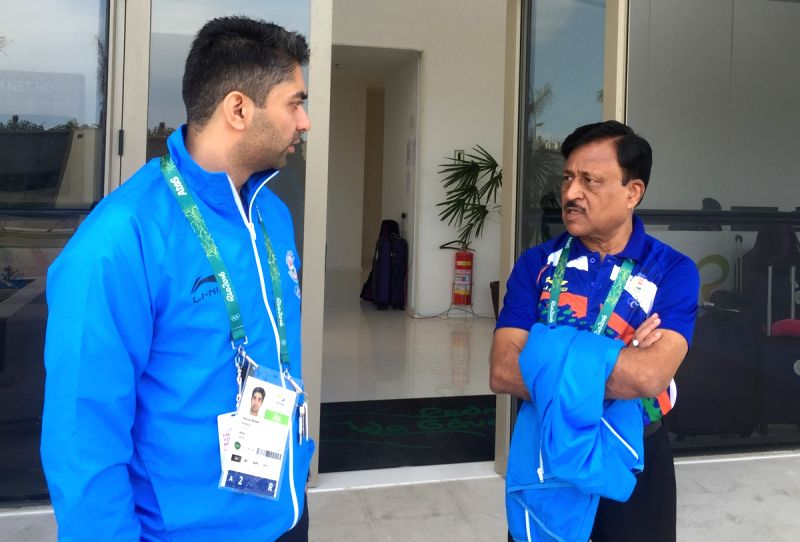Rio De Janeiro: Indian Shooter Abhinav Bindra and Chef de Mission of the Indian contingent Rakesh Gupta at the Olympic Village in Rio De Janeiro on July 31, 2016. - Rakesh Gupta