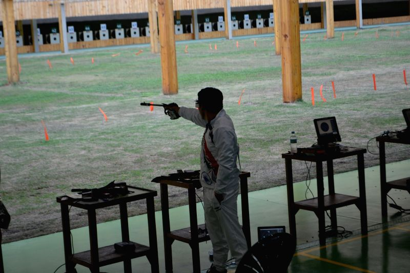 Rio de Janeiro:  Indian shooter Jitu Rai aims at the target during 50M Pistol Qualification of Rio 2016 Olympics in Rio De Janeiro, Brazil on Aug 10, 2016. - Jitu Rai