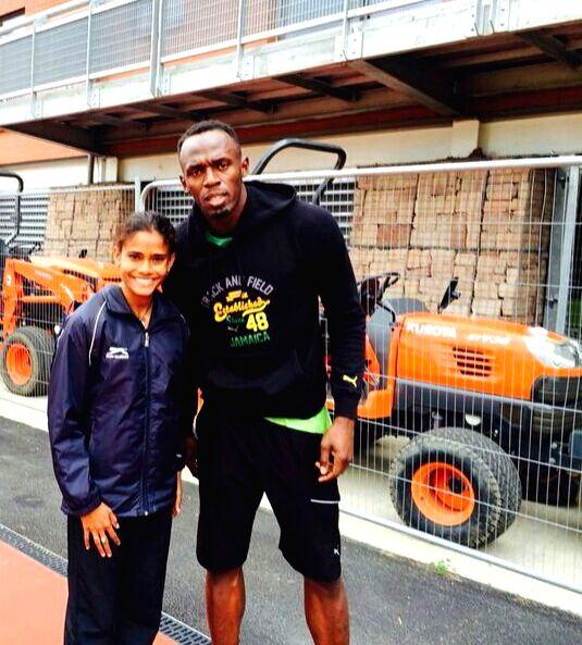 Rio de Janeiro: Indian sprinter Debashree Majumdar meets Jamaican sprinter Usain Bolt in Rio de Janeiro, Brazil on Aug 8, 2016.