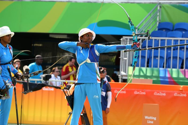 Rio De Janeiro: Indian women archer Laxmirani Manjhi in action while teammate Deepika Kumari looks on as they perform against Russia in the quarter-finals at the Olympic archery stadium in Rio de ...