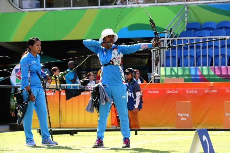 Rio De Janeiro: Indian women archer Laxmirani Manjhi performs as teammate Bombayla Devi looks on at the Olympic archery stadium in Rio de Janeiro on Aug. 7, 2016.  The Indian women's archery team ...