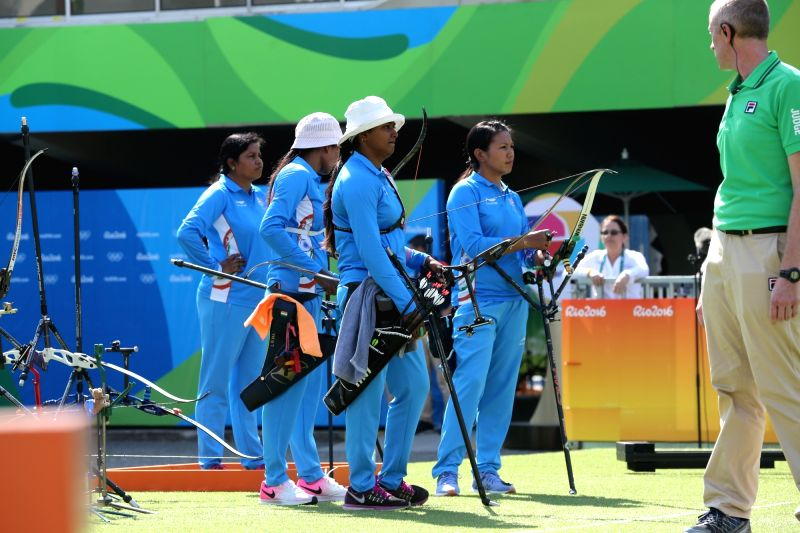 Rio De Janeiro: Indian women archery team Bombayla Devi,  Laxmirani Manjhi and Deepika Kumari perform against Russia in the quarter-finals at the Olympic archery stadium in Rio de Janeiro on Aug. 7, ...