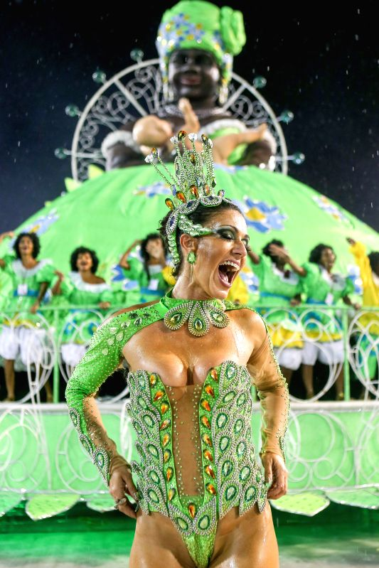 "A performer from the ""Viradouro"" samba school participates in the carnival samba parade at the Sambadrome in Rio de Janeiro, Brazil, Feb. 15, 2015."