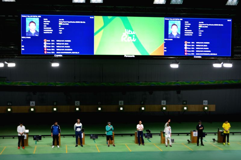 Rio De Janeiro:  Jitu Rai, Indian shooter acknowledges the crowd on being introduced by raising his hand at the 10m Air Pistol men event at Olympic Shooting Centre in Rio de Janeiro before being ... - Jitu Rai