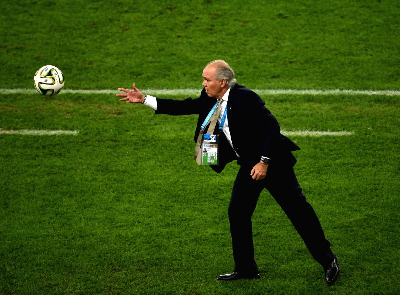 Argentina's coach Alejandro Sabella throws the ball back to the field during the final match between Germany and Argentina of 2014 FIFA World Cup at the ...