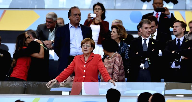 German Chancellor Angela Merkel (front) watches the final match between Germany and Argentina of 2014 FIFA World Cup at the Estadio do Maracana Stadium in ...