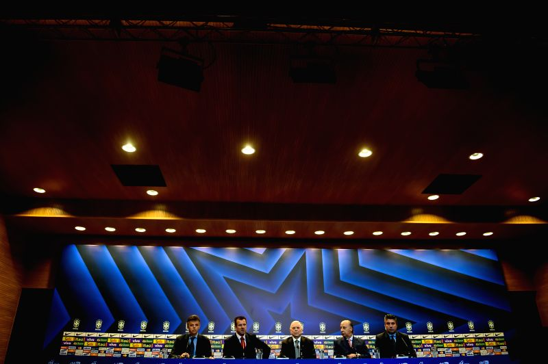 Former player Carlos Caetano Bledorn Verri (2nd L), known as Dunga, attends his presentation as new head coach of Brazil's national soccer team in a press ...
