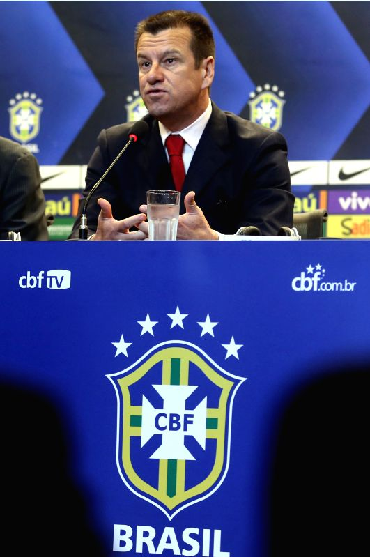 Former player Carlos Caetano Bledorn Verri, known as Dunga, reacts during his presentation as new head coach of Brazil's national soccer team in a press ...