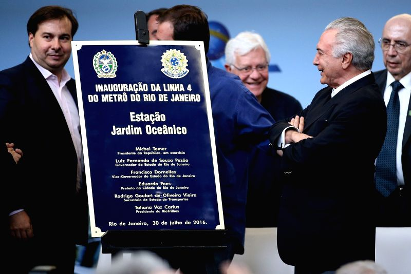 RIO DE JANEIRO, July, 30, 2016 (XINHUA)Brazil's interim President Michel Temer (R, front) attends the inauguration ceremony held at the Jardim Oceacino station of metro line 4 in Barra da Tijuca, ...