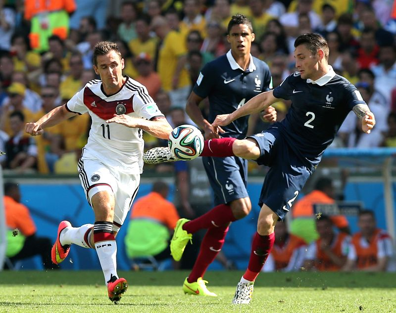 France's Mathieu Debuchy (R) vies with Germany's Miroslav Klose (L) during a quarter-finals match between France and Germany of 2014 FIFA World Cup at the ...