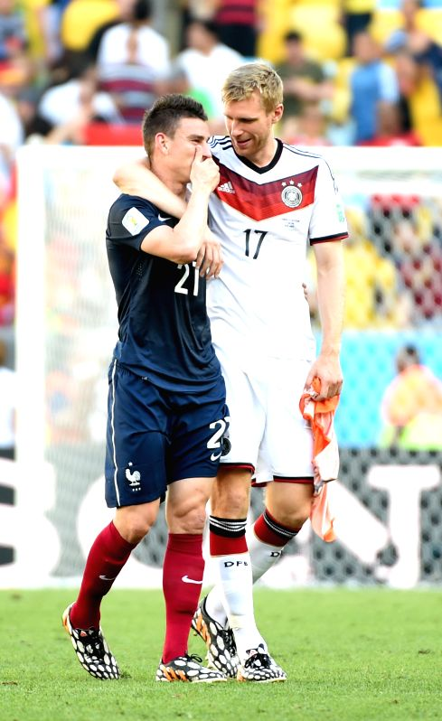 France's Laurent Koscielny speaks with Germany's Per Mertesacker after a quarter-finals match between France and Germany of 2014 FIFA World Cup at the Estadio