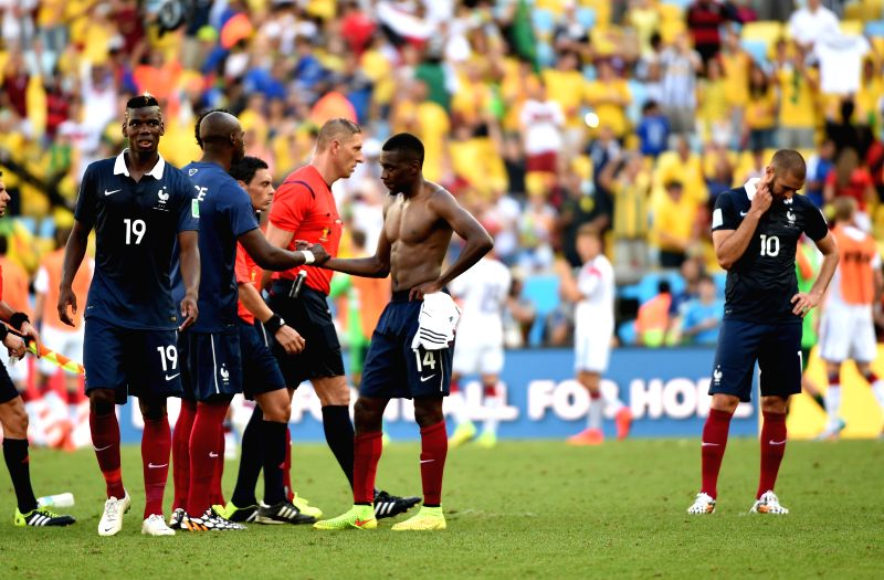France's players react after a quarter-finals match between France and Germany of 2014 FIFA World Cup at the Estadio do Maracana Stadium in Rio de Janeiro, ...