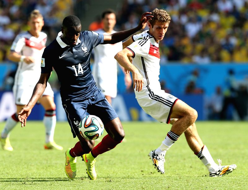France's Blaise Matuidi vies with Germany's Thomas Muller during a quarter-finals match between France and Germany of 2014 FIFA World Cup at the Estadio do ...