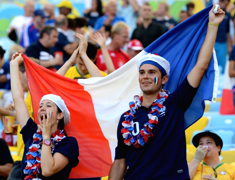 France's fans cheer before a quarter-finals match between France and Germany of 2014 FIFA World Cup at the Estadio do Maracana Stadium in Rio de Janeiro, ...
