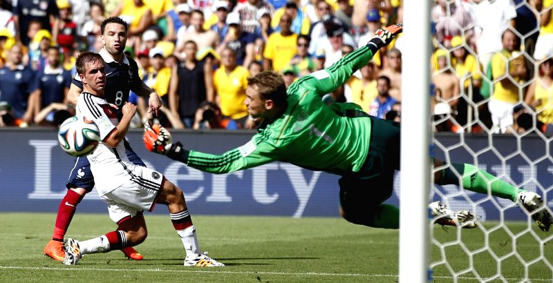 Germany's goalkeeper Manuel Neuer (R) blocks a shot during a quarter-finals match between France and Germany of 2014 FIFA World Cup at the Estadio do Maracana
