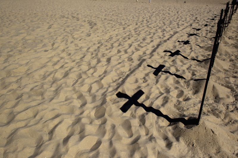 Shadows of crosses are seen during a protest launched by the Group of Comissao de Moradores do Horto in order to call for people's attentions to evictions, ...