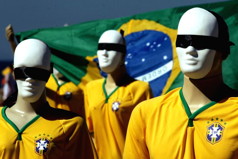 Mannequins with their eyes covered are seen during a protest against the high cost of the FIFA World Cup Brazil 2014, at Copacabana Beach, in Rio de Janeiro, .