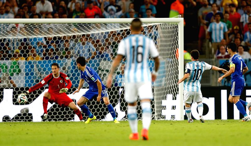 Argentina's Lionel Messi (2nd R) shoots a goal during a Group F match between Argentina and Bosnia and Herzegovina of 2014 FIFA World Cup at the Estadio de ..