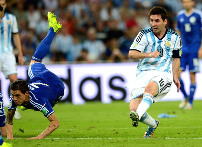 Argentina's Lionel Messi (R) scores a goal during a Group F match between Argentina and Bosnia and Herzegovina of 2014 FIFA World Cup at the Estadio de ...