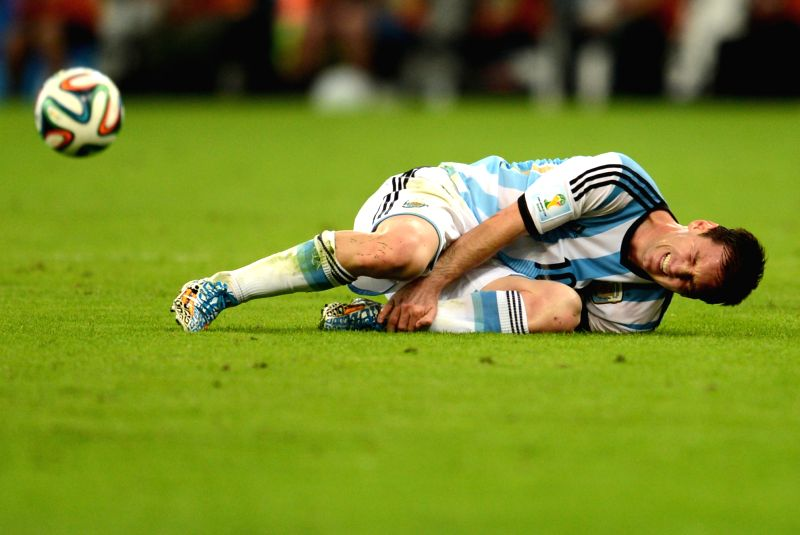 Argentina's Lionel Messi falls down during a Group F match between Argentina and Bosnia and Herzegovina of 2014 FIFA World Cup at the Estadio de Maracana ...