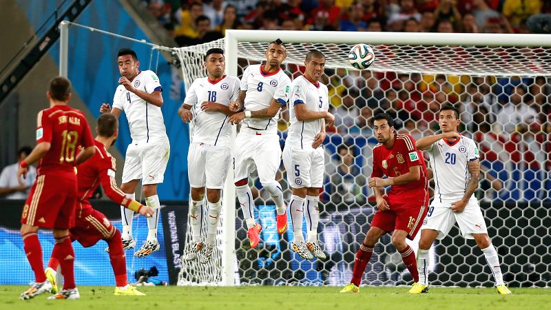 Chile's players defend against a Spain's free kick during a Group B match between Spain and Chile of 2014 FIFA World Cup at the Estadio do Maracana Stadium ..