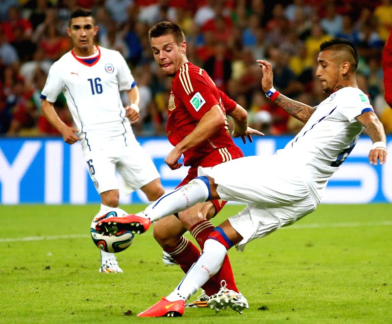 Chile's Arturo Vidal (R) kicks the ball during a Group B match between Spain and Chile of 2014 FIFA World Cup at the Estadio do Maracana Stadium in Rio de ...