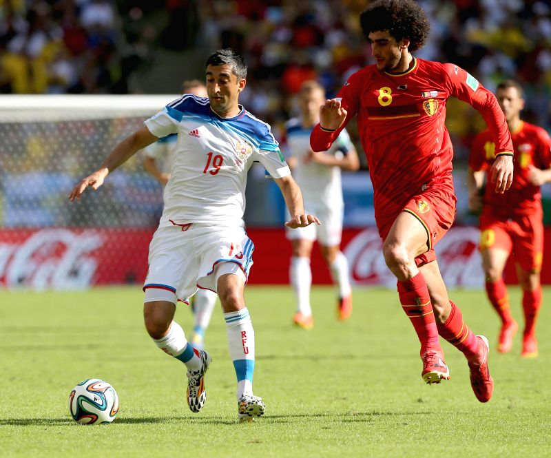 Belgium's Marouane Fellaini vies with Russia's Alexander Samedov during a Group H match between Belgium and Russia of 2014 FIFA World Cup at the Estadio do ...