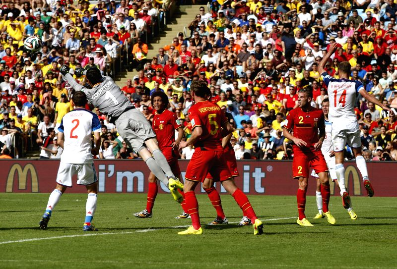 Belgium's goalkeeper Thibaut Courtois (2nd L) blocks a shot during a Group H match between Belgium and Russia of 2014 FIFA World Cup at the Estadio do Maracana .