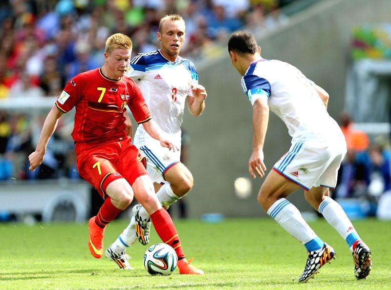 Belgium's Kevin De Bruyne vies for the ball during a Group H match between Belgium and Russia of 2014 FIFA World Cup at the Estadio do Maracana Stadium in Rio ..