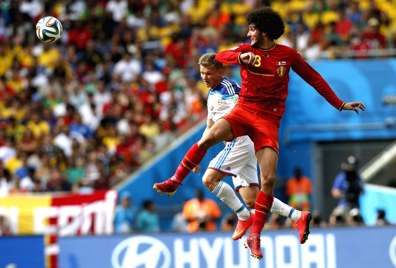 Belgium's Marouane Fellaini (R) competes for a header with Russia's Oleg Shatov during a Group H match between Belgium and Russia of 2014 FIFA World Cup at the .