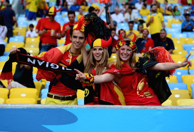 Belgium's fans pose before a Group H match between Belgium and Russia of 2014 FIFA World Cup at the Estadio do Maracana Stadium in Rio de Janeiro, Brazil, June