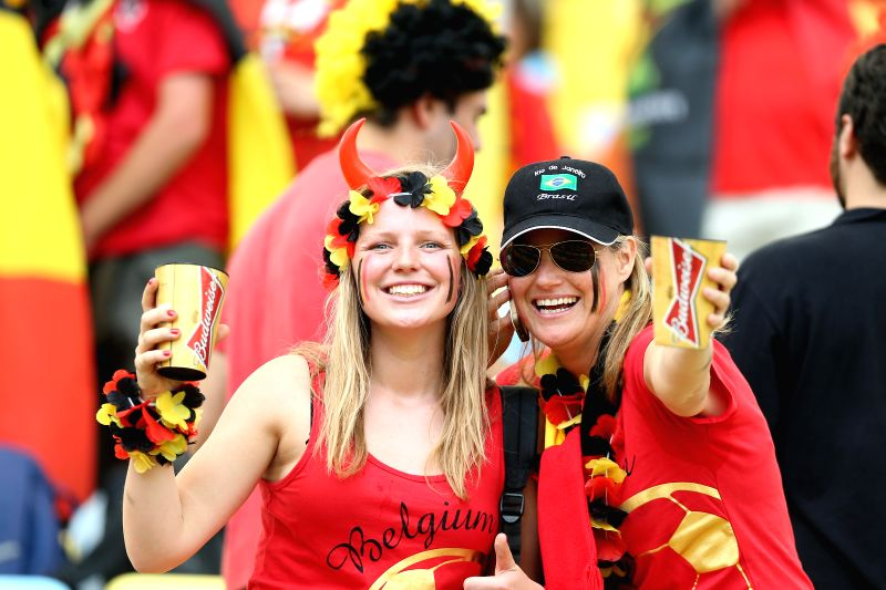 Belgium's fans pose before a Group H match between Belgium and Russia of 2014 FIFA World Cup at the Estadio do Maracana Stadium in Rio de Janeiro, Brazil, June .