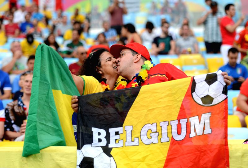 Fans pose before a Group H match between Belgium and Russia of 2014 FIFA World Cup at the Estadio do Maracana Stadium in Rio de Janeiro, Brazil, June 22, ...