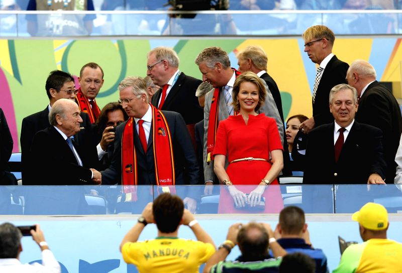 FIFA president Joseph S.Blatter (1st L, front), King Philippe of Belgium (2nd L, front) and Queen Maathilde (3rd L, front) arrive to watch a Group H match ...