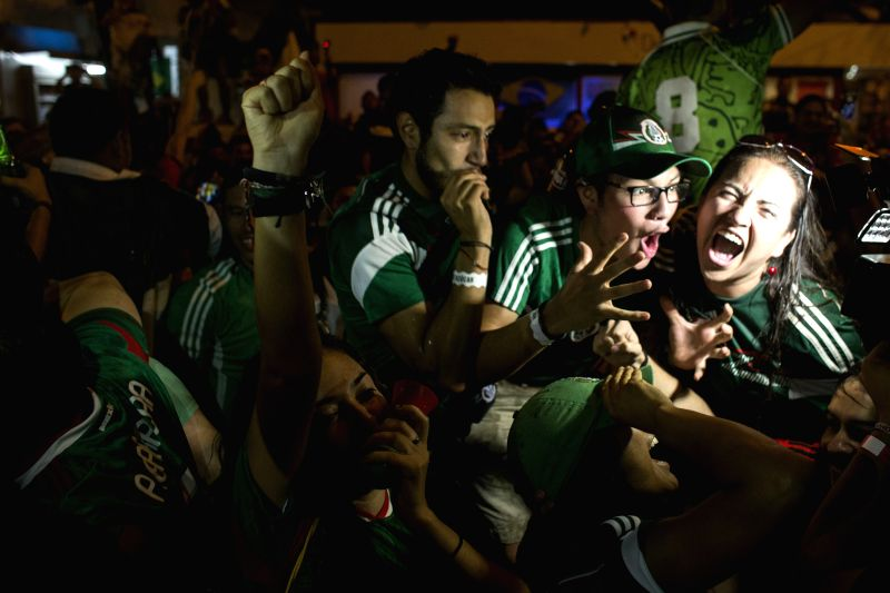 Mexico's fans watch a Group A match between Croatia and Mexico of 2014 FIFA World Cup in Rio de Janeiro, Brazil, on June 23, 2014.  (Xinhua/Guillermo ...