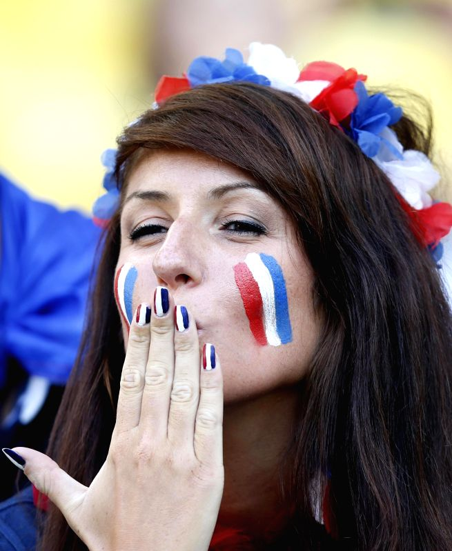 A France's fan poses before a Group E match between Ecuador and France of 2014 FIFA World Cup at the Estadio do Maracana Stadium in Rio de Janeiro, Brazil, ..