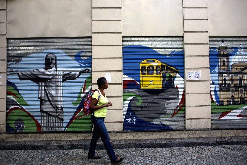 A woman is seen in a street in Rio de Janeiro, Brazil, on June 25, 2014.