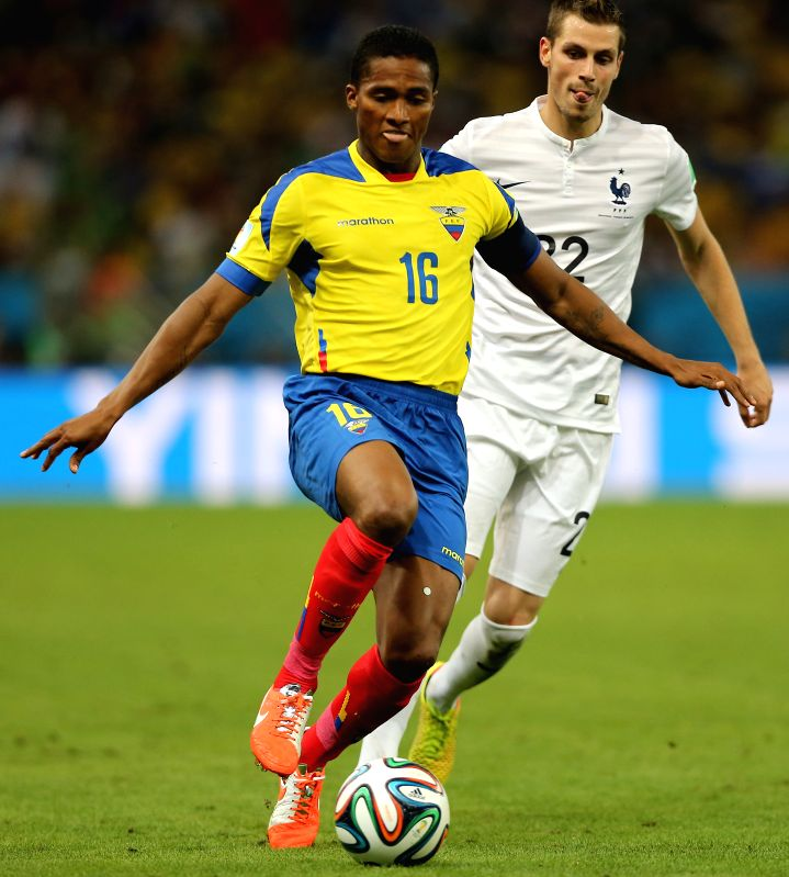 Ecuador's Antonio Valencia vies with France's Clement Grenier during a Group E match between Ecuador and France of 2014 FIFA World Cup at the Estadio do ...